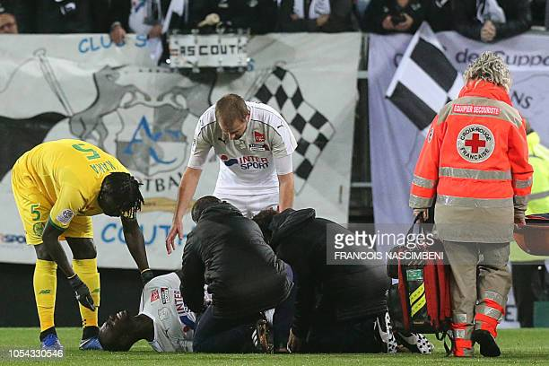 Amiens' forward Moussa Konate reacts as he receives medications after an injury during the French L1 football match between Amiens SC and FC Nantes...