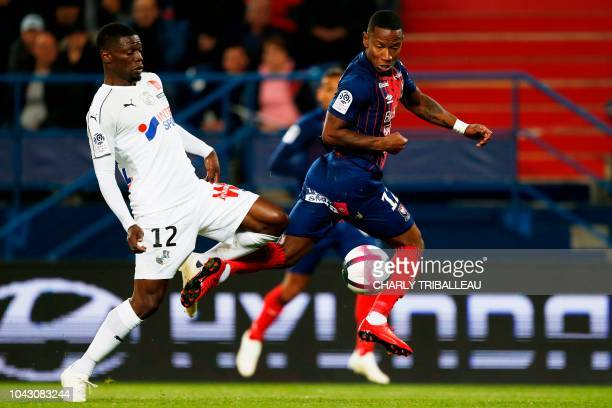 Amiens' FrancoMalian defender Bakaye Dibassy vies for the ball with Caen's French forward Claudio Beauvue during the French L1 football match between...