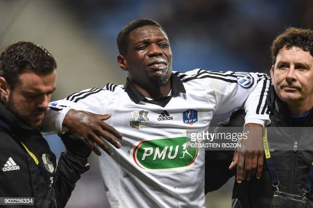 Amiens' French defender Bakaye Dibassy leaves the pitch injured during the French Cup football match between Sochaux vs Amiens at the Auguste Bonal...