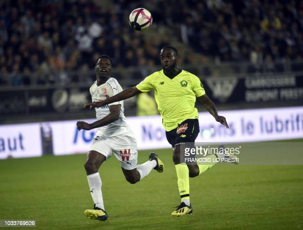 Amiens' French defender Bakaye Dibassy vies with Lille's midfielder Jonathan Ikone during the French L1 football match between Amiens and Lille at...