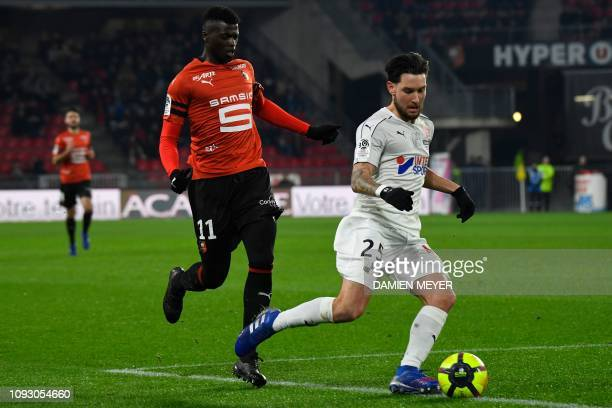 Amiens' French defender Jordan Lefort vies with Rennes' Senegalese forward Mbaye Niang during the French L1 football match between Stade Rennais...
