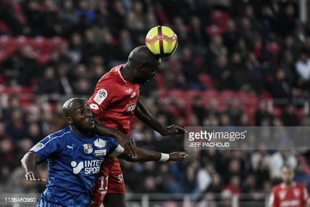 Amiens' French defender Prince Desir Gouano fights for the ball with Dijon's Cape Verdean forward Julio Tavares during the French L1 football match...