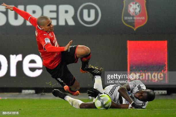 Amiens' French defender Prince Gouano tackles Rennes' Tunisian midfielder Wahbi Khazri during the French L1 football match Rennes vs Amiens on...