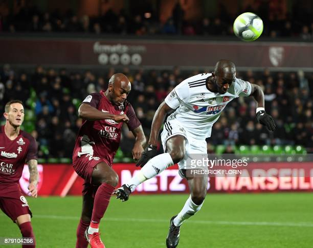 Amiens' French defender PrinceDe Gouano vies with Metz' German defender Philipp Wollscheid during the French L1 football match between Metz and...