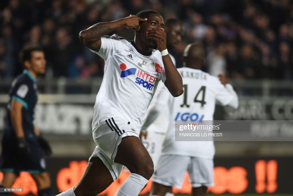Amiens' French forward Harrison Manzala celebrates after scoring a goal during the French L1 football match between Amiens (ASC) and Lille (LOSC) on November 20, 2017, at the Licorne Stadium in Amiens, northern France. /