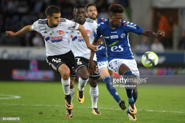 Amiens' French forward Quentin Cornette vies with Strasbourg's Cape Verdian forward Nuno Da Costa during the French L1 football match between...
