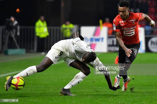 Amiens' French forward Sehrou Guirassy vies with Rennes' Mozambican defender Mexer during the French L1 football match between Stade Rennais Football...