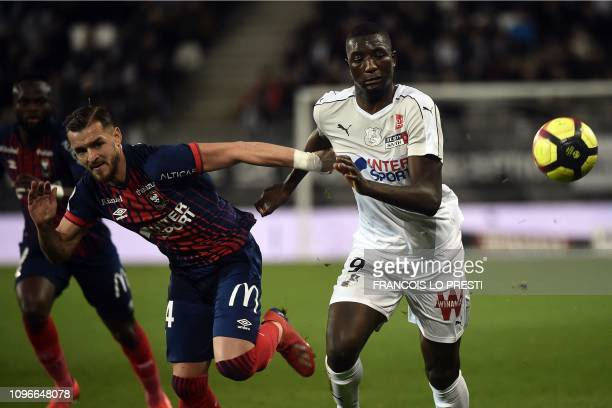Amiens' French forward Serhou Guirassy fights for the ball with Caen's French defender Jonathan Gradit during the French L1 football match between...