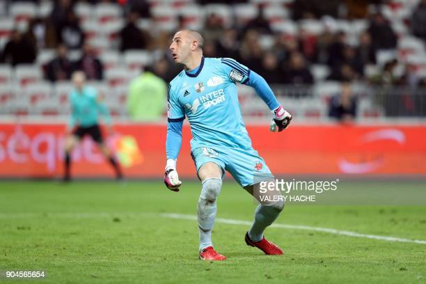 Amiens' French goalkeeper JeanChristophe Bouet looks at the ball as he concedes a goal during the French L1 football match Nice vs Amiens on January...