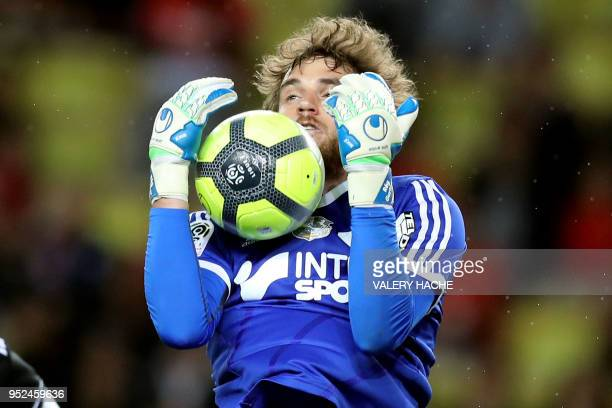 Amiens' French goalkeeper Regis Gurtner stops the ball during the French L1 football match Monaco vs Amiens on April 28 2018 at the Louis II Stadium...