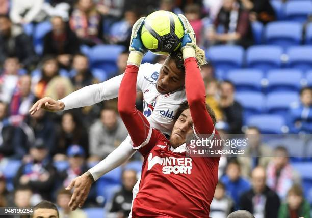 TOPSHOT Amiens' French goalkeeper Regis Gurtner vies with Lyon's Spanish forward Mariano Diaz during the French L1 football match between Lyon and...