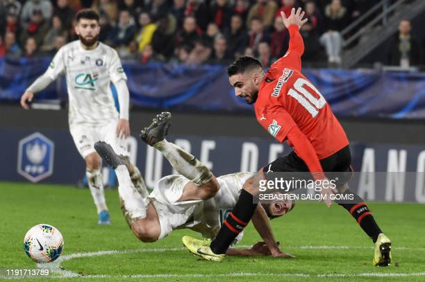 Amiens' French midfielder Alexis Blin vies for the ball with Rennes' French forward Romain Del Castillo during the French Cup football match between...