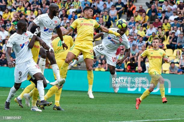 Amiens' French midfielder Cheick Timite heads the ball to score a goal during the French L1 football match between Nantes and Amiens at the La...