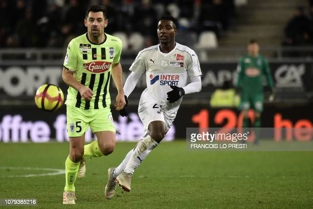 Amiens' French midfielder Cheick Timite vies with Angers' French defender Thomas Mangani during the French L1 football match between Amiens SC and...