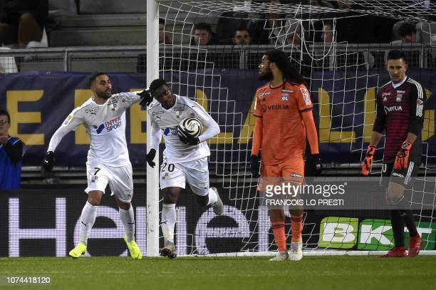 Amiens' French midfielder Cheik Timite is congratuled by teamates after scoring during the French League Cup round of sixteen football match between...