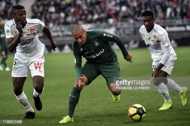 Amiens' French midfielder Eddy Gnahore vies with SaintEtienne's Tunisian midfielder Wahbi Khazri during the French L1 football match between Amiens...