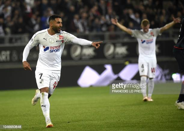 Amien's Irani forward Saman Ghoddos celebrates after scoring during the French L1 football match between Amiens and Dijon on October 6 2018 at the...