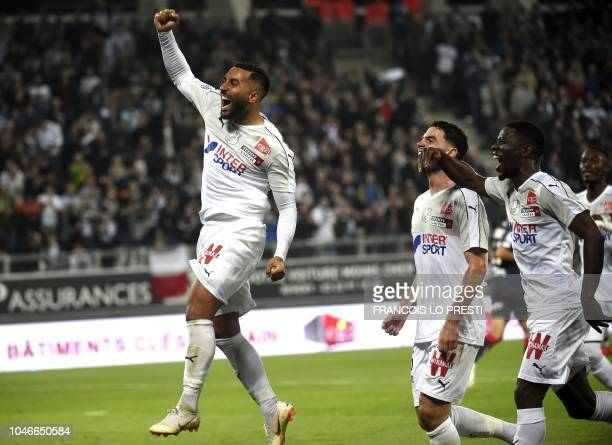 Amien's Irani forward Saman Ghoddos is congratuled by teamates after scoring during the French L1 football match between Amiens and Dijon on October...