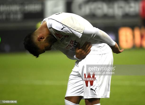 Amien's Irani forward Saman Ghoddosjubilates after scoring during the French L1 football match between Amiens and Dijon on October 6 2018 at the...
