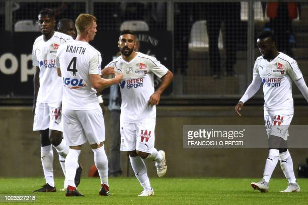 Amiens' Iranian forward Saman Ghoddos celebrates after scoring a goal during the French L1 football match between Amiens and Reims on August 25 at...