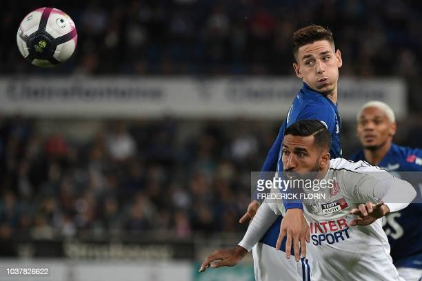 Amiens' Iranian forward Saman Ghoddos vies with Strasbourg's French midfielder Anthony Caci during the French L1 football match between Strasbourg...