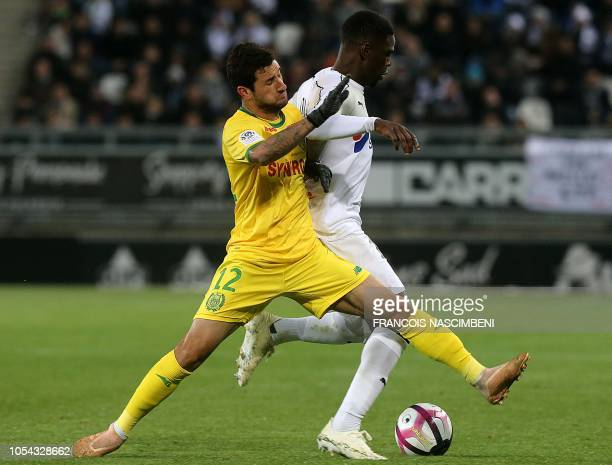 Amiens' Malian defender Bakaye Dibassy vies for the ball with Nantes' Brazilian midfielder Gabriel Boschilia during the French L1 football match...