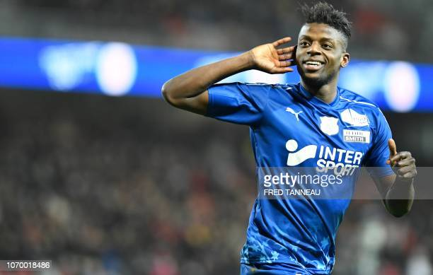 Amien's midfielder Eddy Gnahore celebrates after scoring during the French L1 football match between En Avant Guingamp and Amiens SC at the Roudourou...