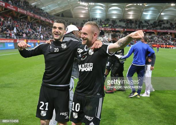 Amiens' midfielder Emmanuel Bourgaud jubilates after scoring the victory's goal during the Ligue 2 Football match ReimsAmiens on May 19 2017 at the...