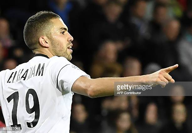 Amiens' Moroccan defender Oualid ElHajjam celebrates after scoring during the French L1 football match between Guingamp and Amiens on October 28 2017...