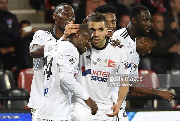 Amiens' Moroccan defender Oualid ElHajjam is congratulated by his teammates after scoring during the French L1 football match between Guingamp and...