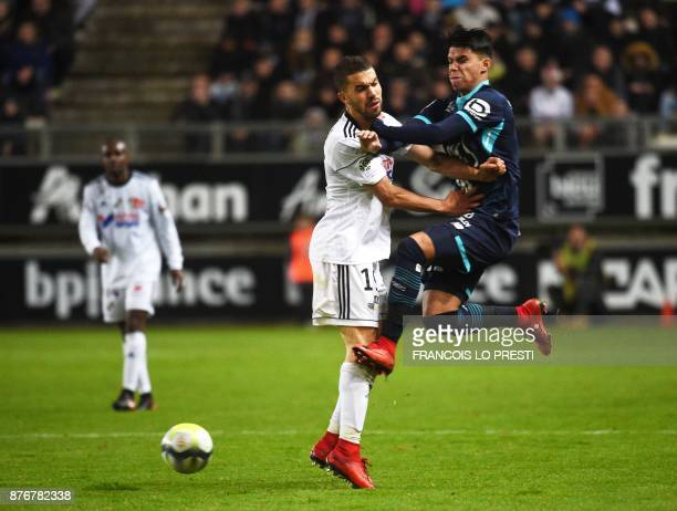 Amiens' Moroccan defender Oualid ElHajjam vies with Lille's Brazilian forward Louis Araujo during the French L1 football match between Amiens and...