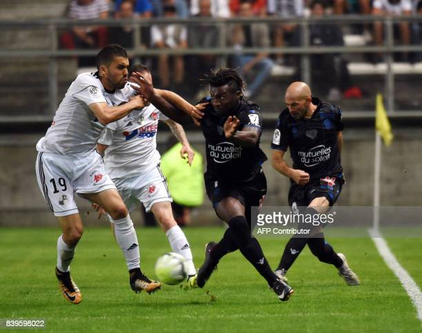 Amiens' Moroccan defender Oualid ElHajjam vies with Nice's French midfielder Pierre LeesMelou during the French Ligue1 football match between Amiens...