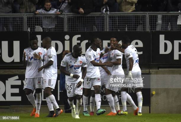 Amien's Moussa Konate jubilates after scoring during the French L1 football match between Amiens and PSG on May 4 2018 at the Licorne stadium in...