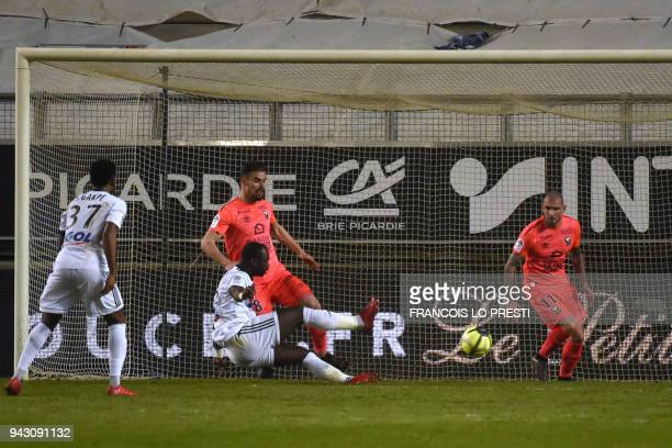 Amiens' Moussa Konate scores a goal during the French L1 football match between Amiens and Caen on April 7 2018 at the Licorne stadium in Amiens /...