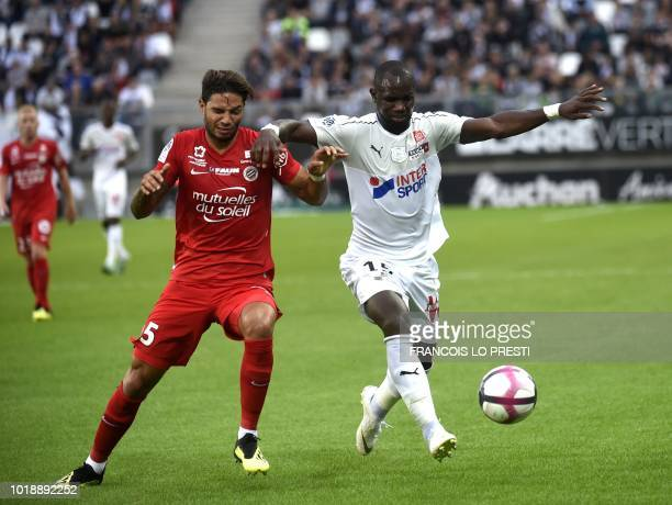 Amiens' Moussa Konate vies with Montpellier' Pedro Mendes during the French L1 football match between Amiens and Montpellier on August 18 2018 at the...