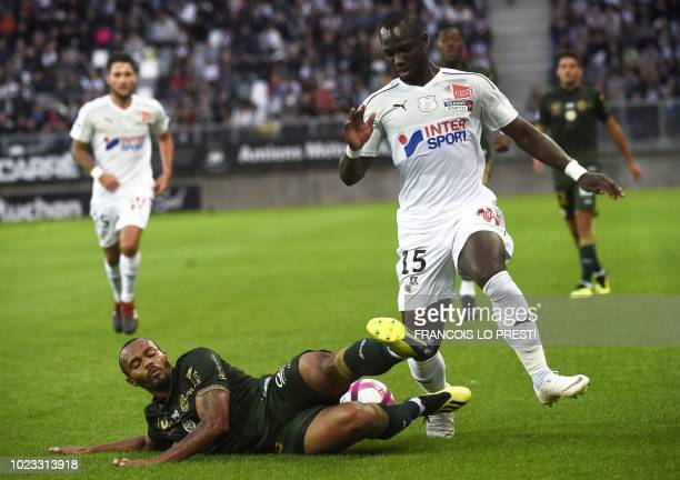 Amiens' Moussa Konate vies with Reims' Jacques Allaixis Romao during the French L1 football match between Amiens and Reims on August 25 at the...