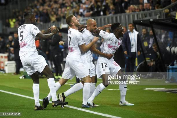 Amiens' Norwegian defender Haitam Aleesami is congratulated by teammates after scoring a goal during the French L1 football match between SC Amiens...