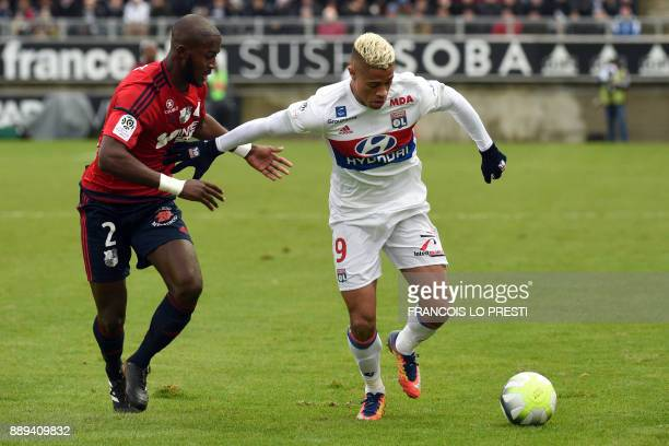 Amiens' PrinceDesir Gouano vies with Lyon's Mariano Diaz during the French L1 football match between Amiens and Lyon on December 10 2017 at the...