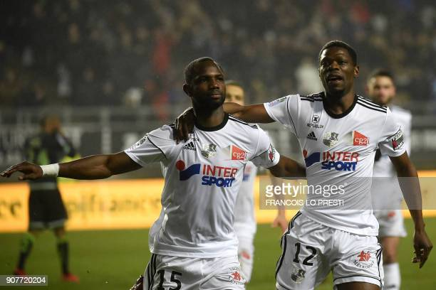 Amiens' Senegales forward Pape Moussa Konate celebrates with teammate Malian defender Bakaye Dibassy after scoring a goal during the French L1...