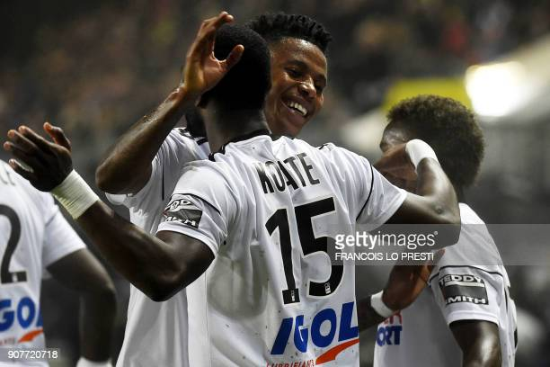 Amiens' Senegales forward Pape Moussa Konate celebrates with teammates after scoring a goal during the French L1 football match between Amiens and...