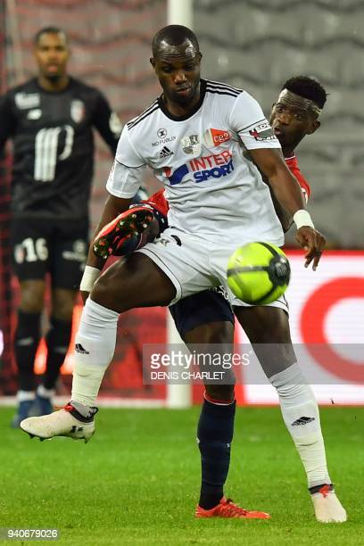 Amiens' Senegalese defender Issa Cissokho holds off Lille's South African forward Lebo Mothiba during the French L1 football match played behind...