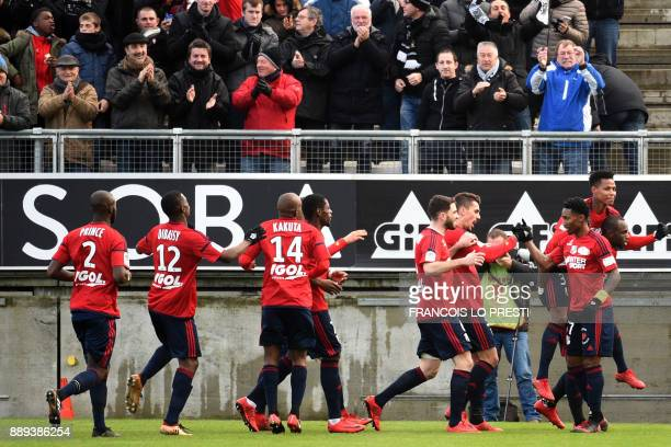 Amiens' Serge Gakpe celebrates after scoring a goal during the French L1 football match between Amiens and Lyon on December 10 2017 at the Licorne...