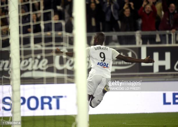 Amiens' Serhou Guirassy jubilates after scoring during the French L1 football match between Amiens and Nice on February 23 2019 at the Licorne...