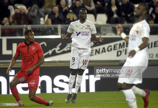 Amiens' Sherou Guirassy jubilates after scoring during the French L1 football match between Amiens and Nice on February 23 2019 at the Licorne...