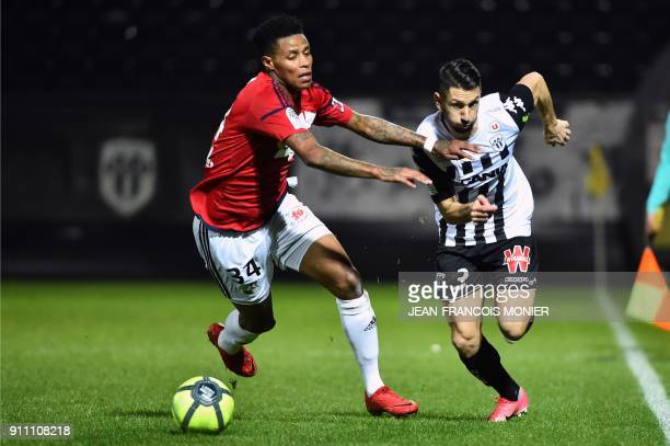 Amiens' SouthAfrican midfielder Bongani Zungu vies with Angers' French defender Yoann Andreu during the French L1 football match between Angers and...