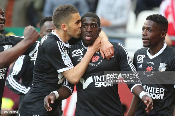 Amiens teammates celebrate after Amiens' forward Aboubakar Famara scored a goal during the Ligue 2 Football match ReimsAmiens on May 19 2017 at the...