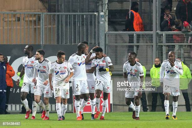 Amiens' teammates celebrate after Amiens' forward Serge Gakpe scored a goal during the French L1 Football match Amiens vs Monaco on November 17 2017...