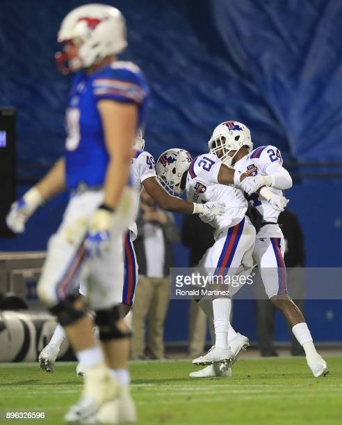 Amik Robertson of the Louisiana Tech Bulldogs celebrates a touchdown interception with L'Jarius Sneed against the Southern Methodist Mustangs in the...