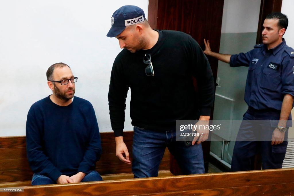 Amikam Shorer (L) form the Israeli Bezeq telecommunication company, appears in the Israeli Justice Court in Tel Aviv in one of the graft probes threatening the Israeli prime minister on February 21, 2018. /