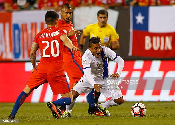 Amilcar Henriquez of Panama attempts to move the ball past Charles Aranguiz and Arturo Vidal of Chile in the second half during the 2016 Copa America...